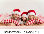 family in christmas santa hats...   Shutterstock . vector #516568711