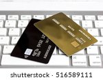 credit cards on the keyboard... | Shutterstock . vector #516589111
