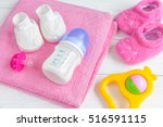 baby bottle with milk and towel ... | Shutterstock . vector #516591115