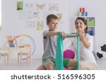 physiotherapist and boy sitting ... | Shutterstock . vector #516596305