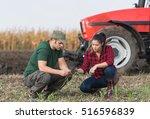 Young Farmers Examing Dirt...