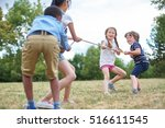 happy group of kids playing tug ... | Shutterstock . vector #516611545