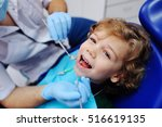 smiling child sitting in a blue ... | Shutterstock . vector #516619135