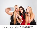 three models in dresses make... | Shutterstock . vector #516628495