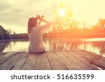 woman with balloons at the lake ... | Shutterstock . vector #516635599