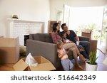 family on sofa taking a break... | Shutterstock . vector #516642349