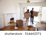 couple carrying boxes into new... | Shutterstock . vector #516642571