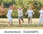 happy seniors winning the... | Shutterstock . vector #516646891