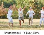 happy seniors winning the... | Shutterstock . vector #516646891