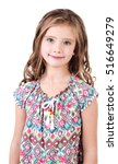 Small photo of Portrait of adorable smiling little girl isolated on a white