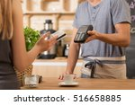 shot of young woman paying by... | Shutterstock . vector #516658885