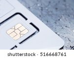 Small photo of nano sim card on cracked mobile phone screen