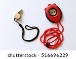 whistle and stopwatch on white... | Shutterstock . vector #516696229