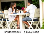 cheerful couple having lunch in ... | Shutterstock . vector #516696355