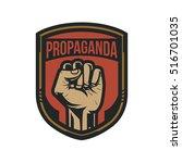 propaganda badge  fist hand   Shutterstock .eps vector #516701035