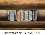 Small photo of tabu word made from vintage letterpress type on wooden tray