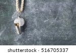 Small photo of whistle of a soccer / football referee or trainer, free copy space