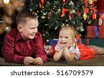 happy boy and girl near... | Shutterstock . vector #516709579