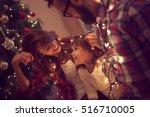 beautiful young family enjoying ... | Shutterstock . vector #516710005