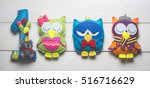 Owls Of Colored Felt On White...