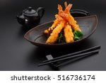 tempura shrimp on a black plate | Shutterstock . vector #516736174