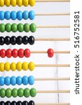 Small photo of Close up of colorful abacus, traditional abacus in front of white background, selective focus.