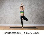 young woman practicing yoga... | Shutterstock . vector #516772321