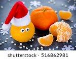 Tangerine With Eyes In Santa...