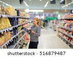 woman shopping in supermarket... | Shutterstock . vector #516879487
