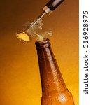 man open fresh cold beer ale... | Shutterstock . vector #516928975