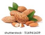 heap of almonds in their skins... | Shutterstock . vector #516961639