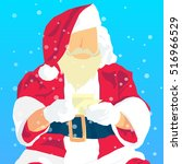 santa claus  holding in his... | Shutterstock .eps vector #516966529