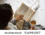 girl reading book and drinking... | Shutterstock . vector #516981007