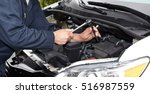 car mechanic with wrench.   Shutterstock . vector #516987559