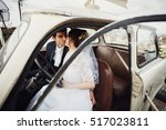 couple kissing in old car on... | Shutterstock . vector #517023811