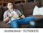 bored couch potato | Shutterstock . vector #517026151