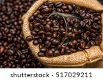 glass and roasted coffee beans | Shutterstock . vector #517029211