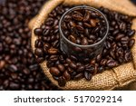 glass and roasted coffee beans | Shutterstock . vector #517029214