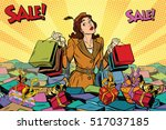 woman with shopping in a sea of ... | Shutterstock .eps vector #517037185