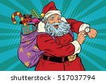 santa claus shows on the clock  ... | Shutterstock .eps vector #517037794