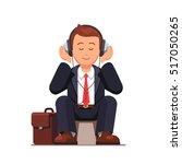 business man listening to music ... | Shutterstock .eps vector #517050265