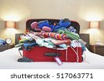open suitcase on bed | Shutterstock . vector #517063771