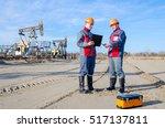 two workers in the oilfield ... | Shutterstock . vector #517137811