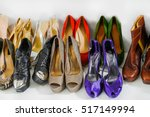 pile of various female shoes | Shutterstock . vector #517149994