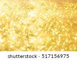 abstract bokeh of golden... | Shutterstock . vector #517156975