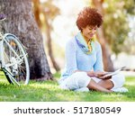 young woman using tablet in the ... | Shutterstock . vector #517180549