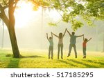 asian family walking outdoor in ... | Shutterstock . vector #517185295