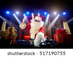 dj santa claus mixing up some... | Shutterstock . vector #517190755