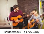 guitar teacher teaching the... | Shutterstock . vector #517222309