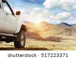 suv car against mountains. 4x4... | Shutterstock . vector #517223371
